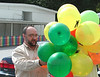 Coastal Electric Cooperative employee Robert Moore tries to untangle balloons that have become co-mingled.
