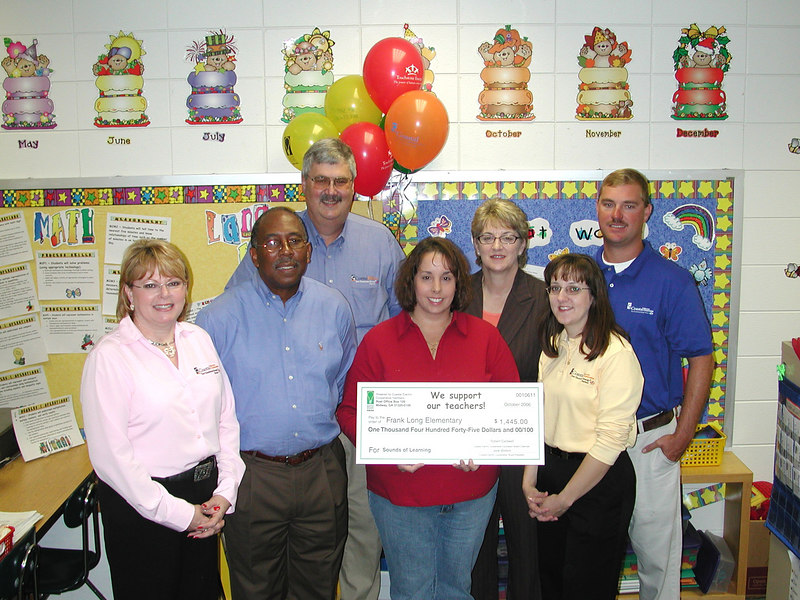 Members of the Bright Ideas Prize Team, employees and directors of Coastal Electric Cooperative and its Foundation, congratulate Bright Ideas winner Susan Fennell on her winning a $1,445 grant for her project, Sounds of Learning.