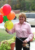 Bright Ideas Prize Team member Becky Tharpe with a bouquet of ballons. The Prize Team comes with balloons and gifts for the winning teachers. The day is all about celebrating the winners.
