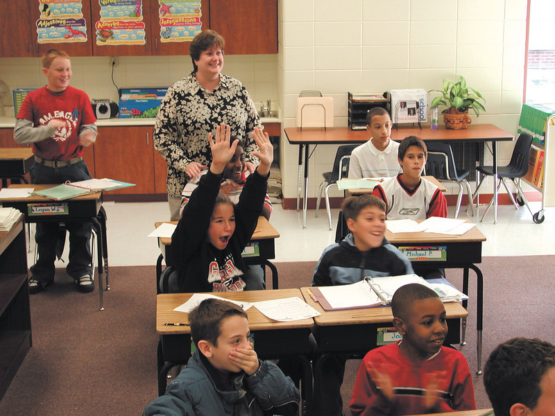 Carver Elementary students in Mary Matthew's class react to news that Matthew's has won a $1,250 grant.