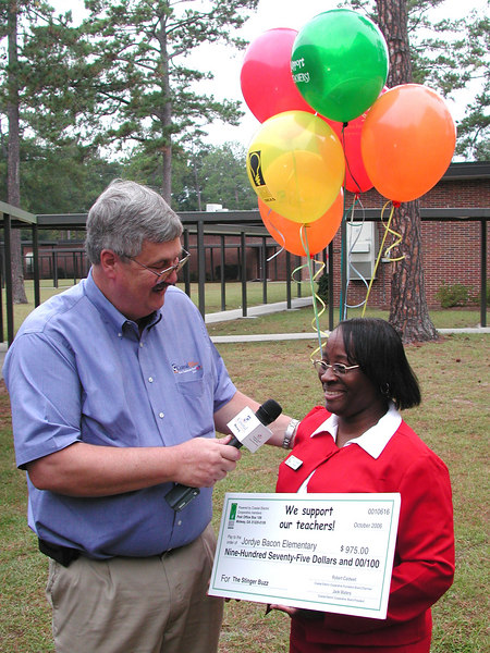 Coastal Electric CEO Whit Hollowell interviews Celestine Barrett at Joryde Bacon Elementary.