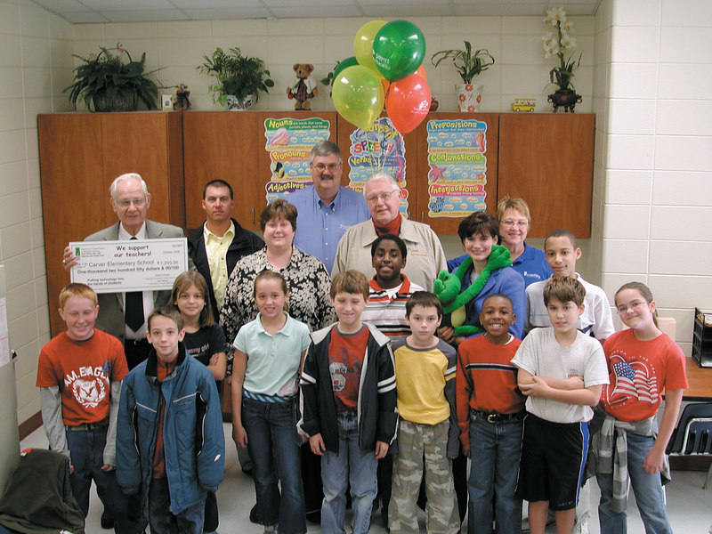 A winning moment - Students, employees, director of the Coastal Electric Board and Foundation Board congratulate Mary Matthew on her $1,250 grant to Put Technology Into the Hands of Students.
