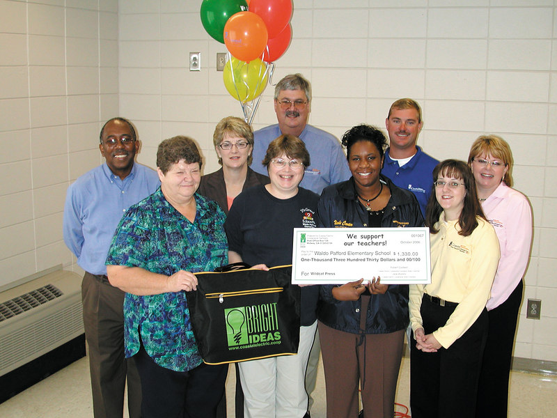 Bright Ideas winner Nicole Carter with other teachers at Waldo Pafford and members of the Bright Ideas Prize Team. Carter and the other teachers were in training that day at Midway Middle School. The Prize Team tracked Carter down to deliver news that she won a grant.