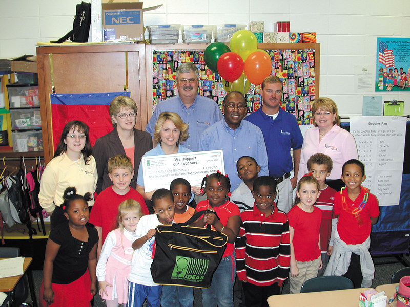 Students in Patricia Moody's class at Frank Long Elementary and members of the Bright Ideas Prize Team, employees and directors of Coastal Electric Cooperative congratulate Moody on winning a grant.