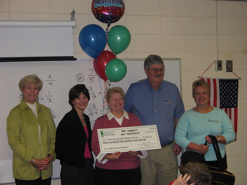 School principal Helen Herndon, Coastal Electric employee Anne Cordeiro, Bright Ideas Winner Sibyl Finnegan, Coastal Electric CEO Whit Hollowell and Coastal Electric employee Diane Williams. Finnegan won a $950 grant for her project, Math Around the Room. She is determined to make math fun.