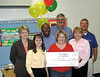 Frank Long Elementary School Teacher Wanda Smith won a $1,435 grant. Pictured with her are members of the Bright Ideas Prize Team who came to visit her and share the good news. The team includes: Coastal Electric employees Cecilia Stender, left of Smith, Becky Tharpe, right of Smith and Clint Durrence, behind Tharpe; Foundation Director Barbara Smith, next to Stender, Board Director Steve Mullice and Coastal Electric CEO Whit Hollowell.