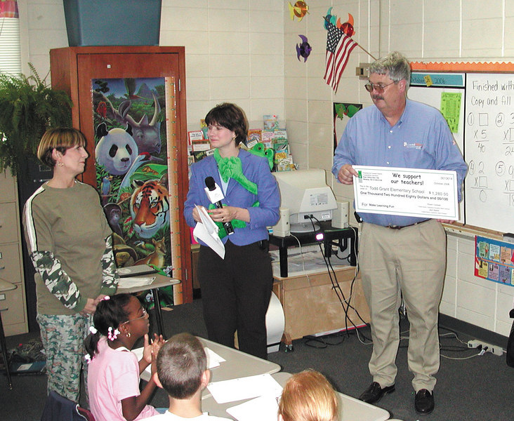 Assistant School Principal Carolyn Smith accepts a $1,280 grant on behalf of Phyllis Smith. Smith wasn't at school the day the Prize Team visited. Her grant will buy supplies to make learning social studies, math, and more fun!