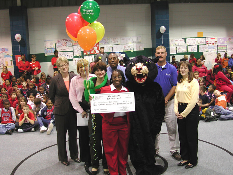 Celestine Barrett with a Liberty County High School Panther, and members of the Bright Ideas Prize Team, employees and directors of Coastal Electric Cooperative and its Foundation.