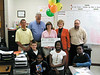 McIntosh County Middle School teacher Cindy Jarriel is congratulated on her winning of a $650 grant to create a traveling book mobile in her school, The Little Red Wagon. With her are students in her class, Coastal Electric Cooperative employees Billy Kirk and Robert Moore, Board member Barbara Davis and Coastal Electric CEO Whit Hollowell.