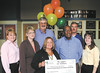 Liberty County High School Principal Paula Scott accepts a $795 grant on behalf of one of her teacher's Amy Dilmar. Dilmar won the grant for her project, Geography Pen Pals. With Scott are Foundation Director Barbara Smith, left, Board Director, Steve Mullice, right, employees of Coastal Electric Cooperative, Becky Tharpe, Cecilia Stender and Clint Durrence, and Coastal Electric CEO Whit Hollowell.