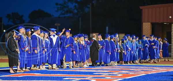 Bullard seniors line the end zone at Panther Stadium as they wait to take their seats at graduation on Thursday, June 4.