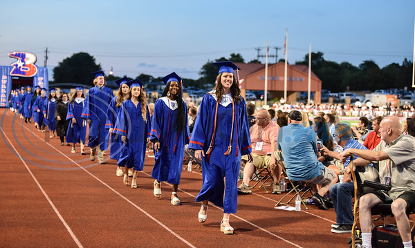 Proud parents look on as Bullard seniors take the field at Panther Stadium for their high school graduation on Thursday, June 4.