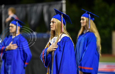 Bullard seniors say the Pledge of Allegiance prior to receiving their diplomas at the school's graduation ceremony held at Panther Stadium