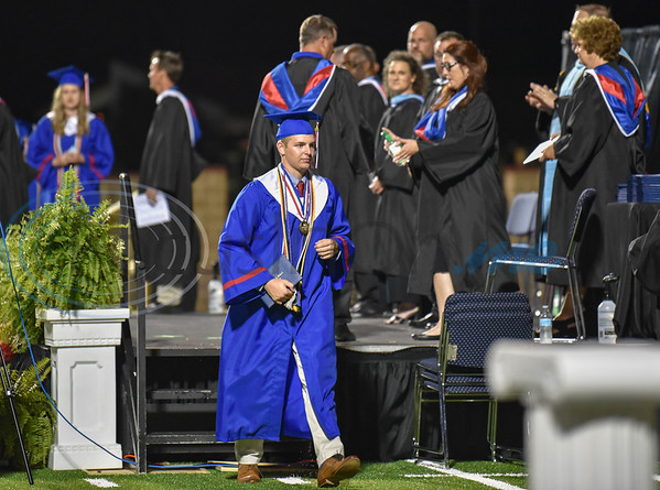 Bullard High School Salutatorian Mason Kelley walks off stage after receiving his diploma at the school's high school graduation on Thursday, June 4.