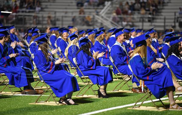 Bullard seniors applaud at their graduation ceremony held at Panther Stadium on Thursday, June 4.