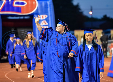 A Bullard senior waves to the crowd while taking the field during the school's graduation ceremony. The celebration took place on Thursday, June 4 at Panther Stadium.