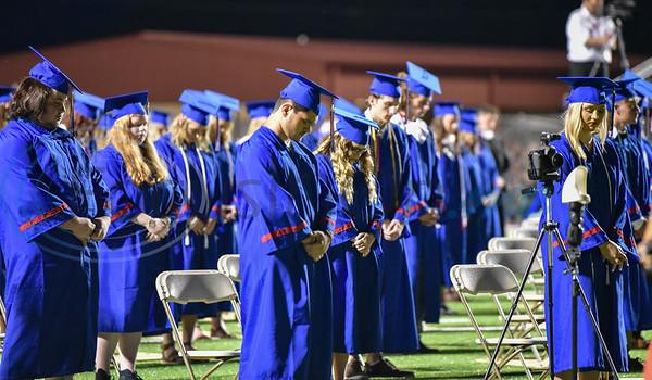 Bullard seniors bow their heads in prayer prior to their graduation ceremony on Thursday, June 4.