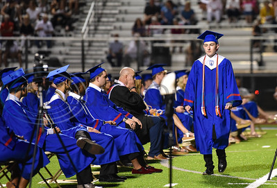 Bullard High School student president Kip Bailey takes his seat after addressing the graduating Class of 2020 at the school's graduation ceremony on Thursday, June 4.