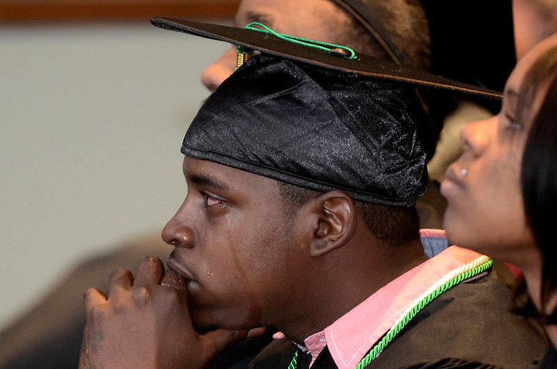 Mike McMahon - The Record, Tears roll down Stenzaya Wallace face as he graduates fron the Troy CEO Youthbuild in a  ceremony at HVCC, Tuesday Febuary 4, 2014