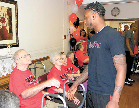 Dan Irwin/NEWS<br /> Malik Hooker, one of the stars of New Castle High's state championship basketball team, visits with residents of the Haven Convalescent Home yesterday,