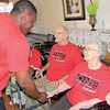 Dan Irwin/NEWS<br /> Stew Allen, part of the New Castle High basketball team entourage that visited the Haven Convalescent Center yesterday, greets resident Mary Bunnell.