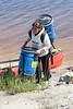Nicole Solomon carrying equipment up from canoe 2006 June 13