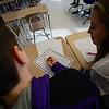 KRISTOPHER RADDER - BRATTLEBORO REFORMER<br /> Brattleboro Union High School students in Erin Hilow's math class read over some of the numbers of Pi as they celebrate National Pi Day on Wednesday, March 15, 2017.