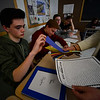 KRISTOPHER RADDER - BRATTLEBORO REFORMER<br /> Brattleboro Union High School student Josh Martin takes a strip of paper as they create a chain with numbers in Pi as they celebrate National Pi Day on Wednesday, March 15, 2017.
