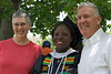 Nora and Jon Almond, now retired from Mathewson Street United Methodist Church, removed their floppy hats for a formal portrait with the graduate.