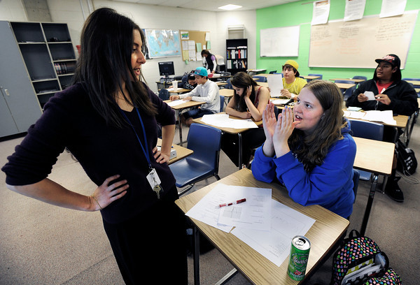 "Centaurus High School teacher Rachelle Lieberman helps sophomore Patricia Miller with a match problem during an Algebra 1B class on Wednesday, Oct. 10, at Centaurus High School in Lafayette. For more photos of the class go to  <a href=""http://www.dailycamera.com"">http://www.dailycamera.com</a><br />  Jeremy Papasso/ Camera"