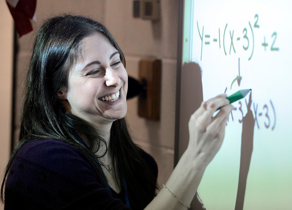 "Centaurus High School teacher Rachelle Lieberman laughs with her students while explaining the answer to a match problem during an Algebra 1B class on Wednesday, Oct. 10, at Centaurus High School in Lafayette. For more photos of the class go to  <a href=""http://www.dailycamera.com"">http://www.dailycamera.com</a><br />  Jeremy Papasso/ Camera"