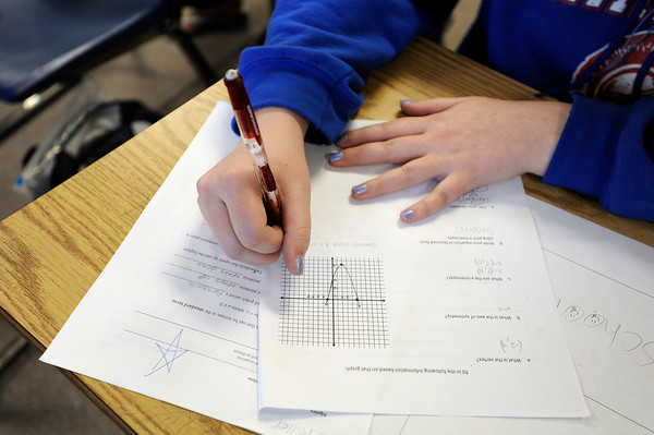 "Centaurus High School sophomore Patricia Miller works to find the answer to a match problem during an Algebra 1B class on Wednesday, Oct. 10, at Centaurus High School in Lafayette. For more photos of the class go to  <a href=""http://www.dailycamera.com"">http://www.dailycamera.com</a><br />  Jeremy Papasso/ Camera"