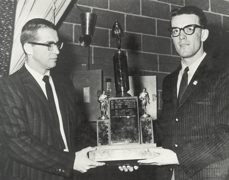 CSC football coach Bill Baker (left) with Eagle end Tom Blundell