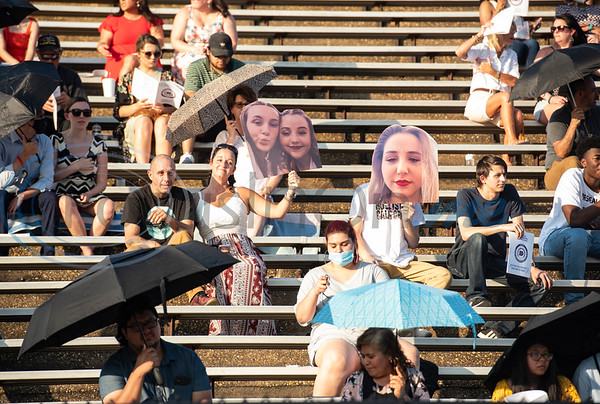 Families seated in the stands hold up photos of their graduates during the commencement ceremony for Chapel Hill High School held at Christus Trinity Mother Frances Rose Stadium in Tyler on Sunday, June 7, 2020.