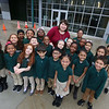 Collegiate Charter School of Lowell first grade teacher Andrea Hatch, with most of her class. She taught her class through radiation and chemotherapy for breast cancer and is now healthy.(SUN/Julia Malakie)