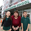 Collegiate Charter School of Lowell first grade teacher Andrea Hatch, with two of her students, Cassidy Rivanis, 6, and Isaiah Laboy, 7. [Other student whose parent talked to reporter was not there.] She taught her class through radiation and chemotherapy for breast cancer and is now healthy.(SUN/Julia Malakie)
