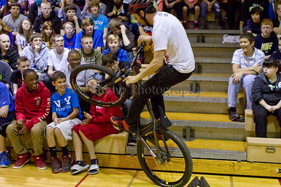 Spring Hill Junior High students Dacoda Cession 14 (front row left), Jake Gerbetz 13 (NY shirt), and Quentin Garcia 13 flinch as Chris Clark, a bicycle stunt rider tease them with a quick stop on Friday April 27,  2013, Springfield Township, Ohio.   Troopers from the Ohio State Highway Patrol and members of the Fraternal Order of Police lodge #157 have combined to cover the cost of the event. Lew Stamp Photography.