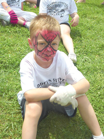 Debbie Wachter/NEWS<br /> Thaddeus Stevens School first-grader Braddy Kriebel, aka Spiderman,  waits his turn to play tug-of-war at the school's carnival on Monday. The day's events included face-painting and  a final closing ceremony of the school.