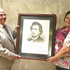 Debbie Wachter/NEWS<br /> Sam Biasucci of Shenango Township, left, holds a print of a drawing of statesman Thaddeus Stevens that he bought for Thaddeus Stevens School 11 years ago. The painting will move to the new Lockley Early Learning Center after a closing ceremony of the school Monday. At right is Thaddeus principal Debbie DeBlasio.