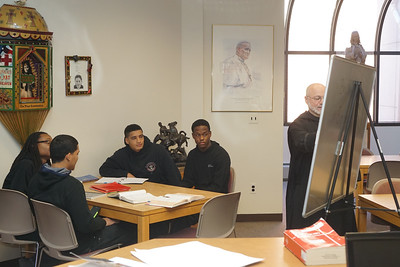 Br. Maximilian Buonocore providing extra help to science and math students in the Radel Library.