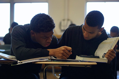 Students help each other in Physics class.
