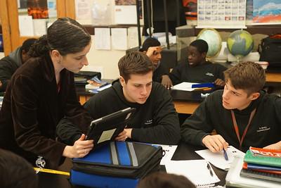 Dean of Faculty and Meteorology teacher Michelle Tuorto works with some of her meteorology students.