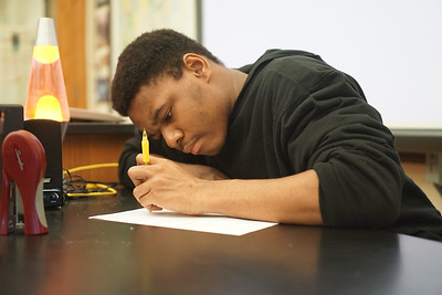 A student concentrates on his meteorology assignment.