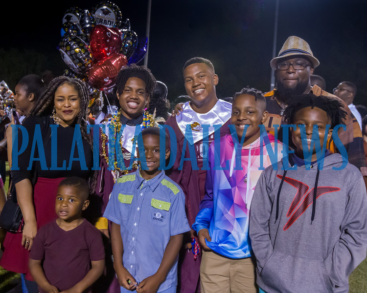 The Washington-Johnson families pose for a portrait with their two Crescent City High School graduates. Fran Ruchalski/Palatka Daily News