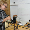Alex Forsythe, 10, demonstrates his electric motor display at the 20th Annual Science, Math and Technology Fair at Crocker Elementary School on Tuesday.