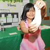 "Kira Lor, 5, demonstrates her ""Ooey Gooey Slime"" at the 20th Annual Science, Math and Technology Fair at Crocker Elementary School on Tuesday."