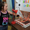Olivia  Cormier, 10, demonstrates her solar oven during Tuesday's 20th Annual Science, Math and Technology Fair at Crocker Elementary School in Fitchburg.