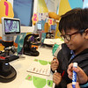 MilliporeSigma's mobile science lab, the Curiosity Cube, visits the Moody Elementary School in Lowell. Fifth grader Maddox Touch checks off the type of cells he'd looked at through the microscopes. (SUN/Julia Malakie)