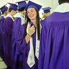 Alexandra Wolf tries to keep cool during the 141st commencement ceremony at Cushing Academy in Ashburnham on Saturday morning. SENTINEL & ENTERPRISE / Ashley Green