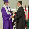 Drew Benedict receives his diploma from Headmaster Chrostopher Torino during the 141st commencement ceremony at Cushing Academy in Ashburnham on Saturday morning. SENTINEL & ENTERPRISE / Ashley Green